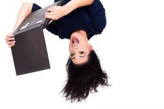 Uppochnervänd bärbar dator Royaltyfri Foto