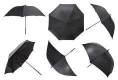 Uppsättning av öppna svarta stora paraplyer Arkivfoton
