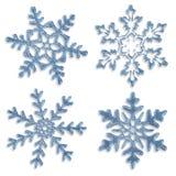 Uppsättning av blåa iskalla snöflingor Arkivfoto