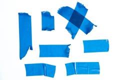 Uppsättning av blåa maskeringstejpstycken Arkivfoton
