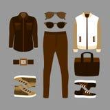Uppsättning av bruna moderiktiga mäns kläder och tillbehör garderob för män s Fotografering för Bildbyråer