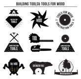 Uppsättning av byggnadshjälpmedel och hjälpmedel för trä och logoemblem, klistermärkear Arkivfoton