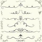 Uppsättning av calligraphic designbeståndsdelar och sidagarnering Royaltyfri Foto