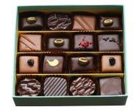 Uppsättning av chokladbrända mandlar Fotografering för Bildbyråer
