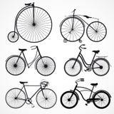 Uppsättning av cyklar på en vit bakgrund Arkivbild