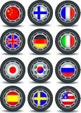 Uppsättning av datorsymboler med flaggor på gummihjulet Arkivfoto