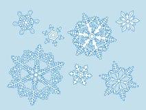Uppsättning av de blåa snöflingorna Arkivfoton