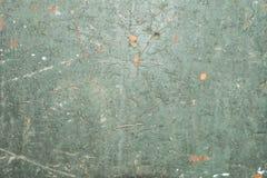 Uppsättning av defekter och sprickor på en gammal målad yttersida, grön textur av ett forntida målat trä, abstrakt bakgrund Arkivfoton