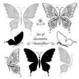 Uppsättning av dekorativa fjärilar och beståndsdelar, handteckning Royaltyfria Bilder