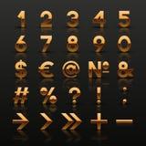 Uppsättning av dekorativa guld- nummer och symboler Arkivbild