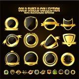 Uppsättning av den guld- skölden, klistermärkear, etiketter, band Arkivbild