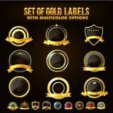 Uppsättning av den guld- skölden, klistermärkear, etiketter, band Royaltyfri Foto