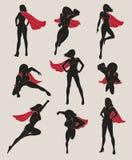 Uppsättning av den kvinnliga superheroen Arkivbild