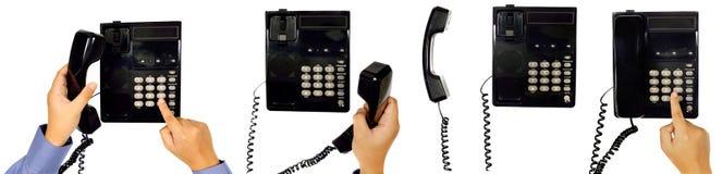 Uppsättning av den manliga handen genom att använda telefonen Arkivbilder