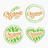 Uppsättning av den skriftliga bokstäverlogoen för organisk hand, etikett, emblem, emblem med nytt ljust - gräsplan arkivbild