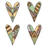 Uppsättning av drog dekorativa stiliserade barnsliga hjärtor för vektor hand Klotterstil, stam- grafisk illustration Dekorativ gu Arkivfoton