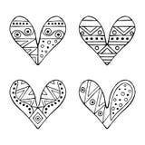 Uppsättning av drog dekorativa stiliserade svartvita barnsliga hjärtor för vektor hand Klotterstil, grafisk illustration Dekorati Arkivfoto
