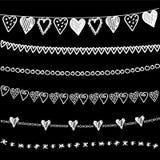 Uppsättning av drog girlander för kritaklotter hand, gränser på svart tavla stock illustrationer