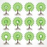 Uppsättning av ecosymboler på träd Fotografering för Bildbyråer