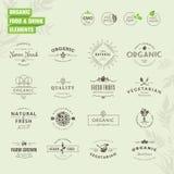 Uppsättning av emblem och etikettbeståndsdelar för organisk mat och drink