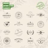 Uppsättning av emblem och etikettbeståndsdelar för organiskt stock illustrationer