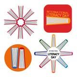 Uppsättning av en bok för internationell läs-och skrivkunnighetdag Arkivfoto