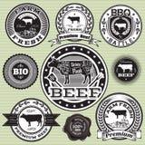 Uppsättning av etiketter med kon och nötkött Arkivfoton