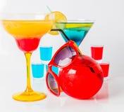 Uppsättning av färgdrinken, olika former av exponeringsglas, drinkskott Royaltyfria Foton
