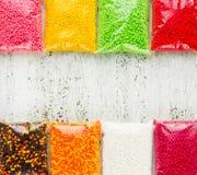 Uppsättning av färgrik sockerbestänkande Arkivbild