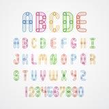 Uppsättning av färgrika alfabetversalar A till Z och nummer Fotografering för Bildbyråer