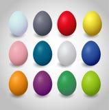 Uppsättning av färgrika easter ägg på en vit bakgrund fotografering för bildbyråer