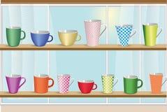 Uppsättning av färgrika koppar för kaffe och för te Arkivbilder