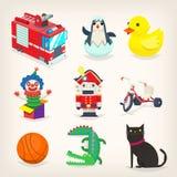 Uppsättning av färgrika leksaker för ungelekar och retro julgåvor Royaltyfri Bild
