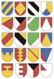 Uppsättning av färgrika mallar för vapensköldar Samling av twent Royaltyfri Illustrationer
