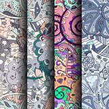 Uppsättning av färgrika sömlösa modeller för tracery Krökta klottra bakgrunder för textil eller utskrift med mehndi- och person s Arkivbilder