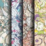 Uppsättning av färgrika sömlösa modeller för tracery Krökta klottra bakgrunder för textil eller utskrift med mehndi- och person s Royaltyfri Bild