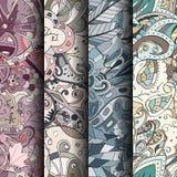 Uppsättning av färgrika sömlösa modeller för tracery Krökta klottra bakgrunder för textil eller utskrift med mehndi- och person s Arkivfoto