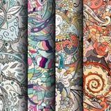 Uppsättning av färgrika sömlösa modeller för tracery Krökta klottra bakgrunder för textil eller utskrift med mehndi- och person s Fotografering för Bildbyråer