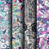 Uppsättning av färgrika sömlösa modeller för tracery Krökta klottra bakgrunder för textil eller utskrift med mehndi- och person s Royaltyfri Fotografi