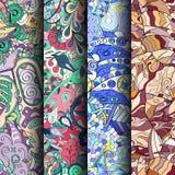 Uppsättning av färgrika sömlösa modeller för tracery Krökta klottra bakgrunder för textil eller utskrift med mehndi- och person s Royaltyfria Bilder