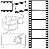 Uppsättning av filmremsor och photocamera Arkivbild