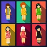 Uppsättning av flickalägenhetsymboler med färgrika klänningar Royaltyfria Foton