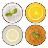 Uppsättning av fruktsmoothie och fruktfruktsaft i exponeringsglas som isoleras på whi Arkivfoton