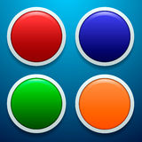 Uppsättning av fyra exponeringsglas, deprimerade knappar i olika färger Royaltyfri Foto