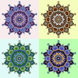 Uppsättning av fyra färgade versioner av en mandalamodell Arkivbilder