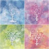 Uppsättning av fyra landskap med abstrakta träd Arkivfoto
