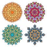 Uppsättning av fyra målat glassmandalas Arkivbilder