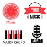 Uppsättning av fyra musiklogotyper (rekord, mikrofon, piano, hörlurar) Royaltyfri Foto