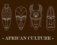 Uppsättning av fyra traditionella afrikanmaskeringar på en brun bakgrund vektor illustrationer