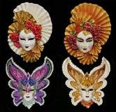 Uppsättning av fyra Venetian isolerade karnevalmaskeringar Royaltyfri Fotografi